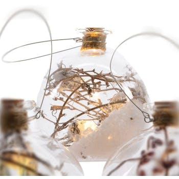 Boule en verre avec LED décor branches D10cm