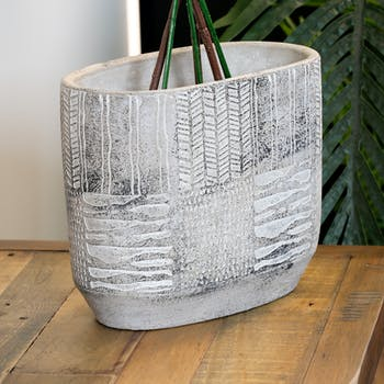 Cache-pot ovale en ciment gris