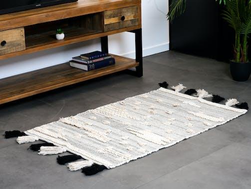 Tapis Evasion tissage coton couleur naturelle avec pompons noirs et écrus 80x120cm