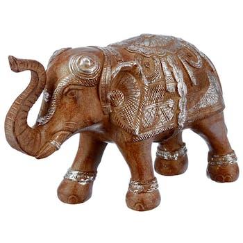 Eléphant avec la trompe levée en résine couleur caramel 23x9xH15cm