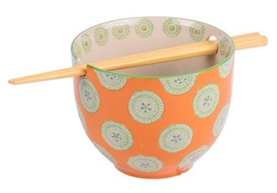 Bol décoré orange avec baguettes