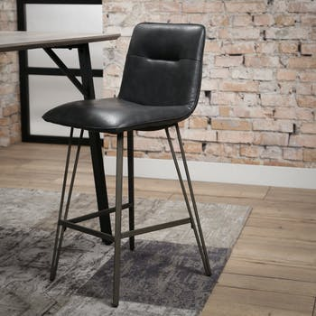 Chaise haute de bar noire style contemporain assise rembouree