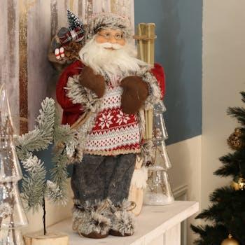 Père Noël figurine en habits rouges et skis 45 cm