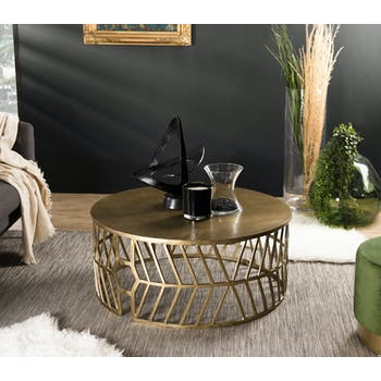 Table basse ronde en metal dore de style contemporain