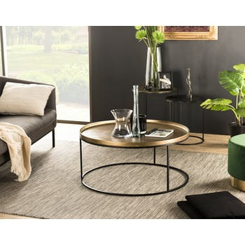 Table basse ronde en metal dore et noir de style contemporain